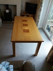 Heavy solid wood dining table 71l x 35w x 28h (108x90x70) perfect condition.