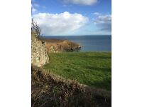 NEWTONHILL, TWO BEDROOM END TERRACED HOUSE WITH GARAGE AND GREAT SEA VIEWS