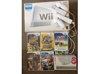 Wii Console, x2 controllers, 6 games
