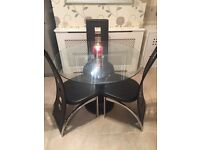 Round glass dining table with 3 dining chairs