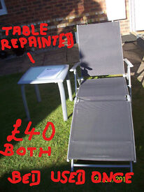 SILVER/BLACK AS NEW TEXTILENE GARDEN BED& SILVER METAL /GLASS SIDE TABLE( SOME WEAR)