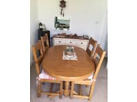 Extendable dinning table and 4 chairs 140cm long to 200cm medium oak. To collect