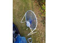 Golf ball net, 245 golf balls, tees and plastic scoring card.