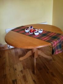 Solid pinewood round table . pick up only
