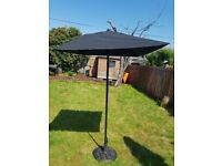 Black garden parasol and stand