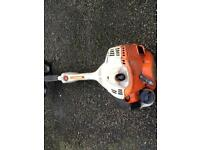 Stihl km56 kombi engine with hedge trimmer attachment