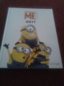 Despicable Me Annual Book & 2 dvd's for sale.