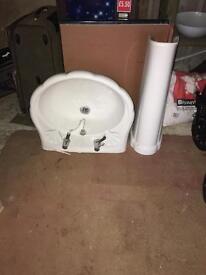 White Sink Taps and Pedestal