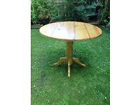 Large Circular Pine Table - Pedestal Base with 2 Drop Leaves