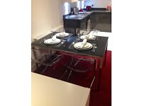 Black glass and chrome Ikea Torsby and Tobias dining table and chairs set