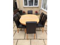 Pine Table with 6 Oak Leg and Leather Back Chairs