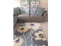 Rug, pictures and cushions all matching.
