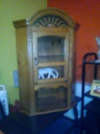 Pine corner cabinet with light