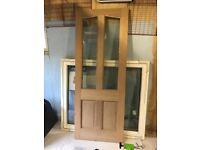 Two hardwood external doors, with double glazed upper quarter panels. 195cm x 75cm