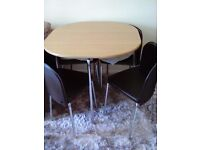 Space saving oak effect table and 4 brown/chrome chairs