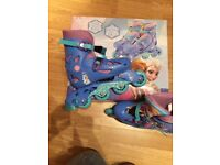 Children's frozen roller blades never worn brand new with box size 13-3 adjustable strap