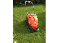Flymo lawn mower with extra long easy reel extension lead and large grass collection box.