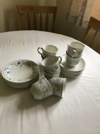 Cup and saucers with tea plates