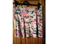 floral H&M skater skirt with zip detail up the back size M