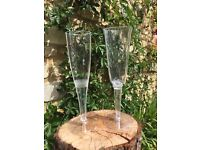Over 100 Unused, disposable, plastic champagne or prosecco flutes