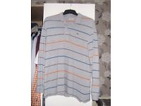 Lacoste grey striped polo shirt size large (regular fit).