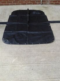 Tonneau NEW, black, convertible cover/top zip down middle with snaps steering wheel mould in cover.