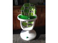 Cosatto 360 highchair in green colour for £60.