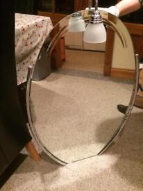 Mirror with overhead light