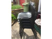 Black plastic stackable bucket seat chairs x 8