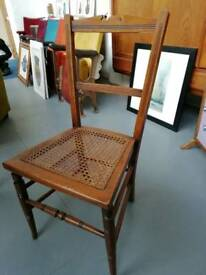 Wooden. Chair with rattan seat.