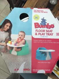 Bumbo seat with harness and tray in box