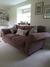 Two brown 'Sofa Sofa' sofas. Removable covers. Still in great condition. Decorative cushions NOT inc