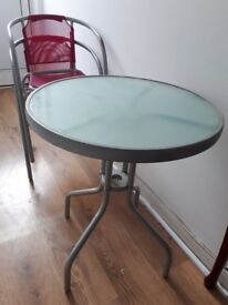 Outdoor glass table and 2 chair set. Collection Only.