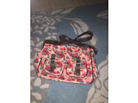 Pink floral oilcloth wipeable shoulder bag with pockets and zip. Pretty ditsy and girly!