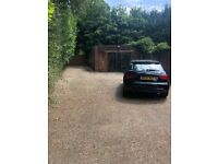 Five car garage with small office space available for storage/ workshop.