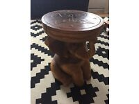 Carved wooden elephant table