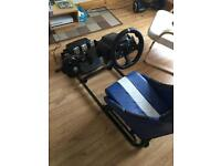 Racing sim play seat with complete Logitech g920 steering wheel pedals and gear shifter