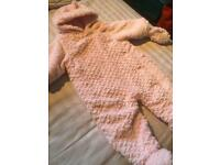 Very fluffy all in one snow suit. 9-12 months