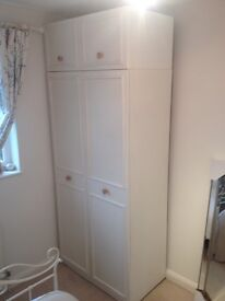 Double wardrobe with top storage