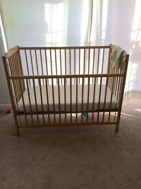Ikea Baby cot bed with good quality mattress excellent condition..