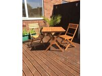 Two seater wooden patio set