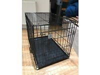 Black metal cage suitable for a small dog, barely used in excellent condition.