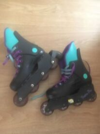 Pair of roller skates, size 1 to 2 hardly used.