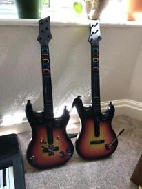 Two Guitar Hero Guitars