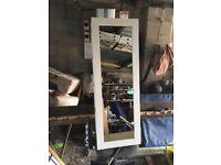 Mirrored vertical storage unit
