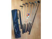 Set of 7 golf clubs, leather bag, balls, tees