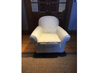 Large Rocking ArmChair. Great chair to sit in with babies to feed or read to them or just comfy seat