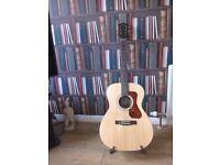 Guild electro acoustic guitar OM 240 e for sale excellent condition.