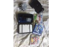 White Nintendo 3DS for sale + 3 games, game pad extension and blue case