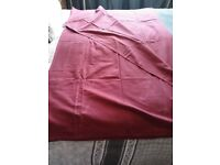 5 red fabric tablecloths. Assorted sizes.